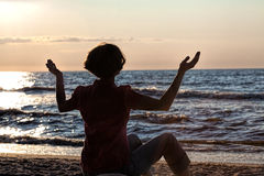 Meditation at sunset Royalty Free Stock Photo