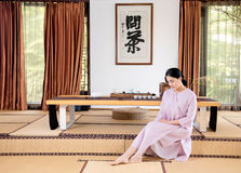 Meditation thinking-China tea ceremony. China woman show China tea ceremony in classical Chinese teahouse Stock Photo