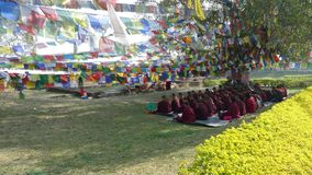Meditation of Tibetan monks. Lumbini Royalty Free Stock Photography