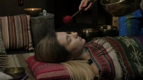 Meditation with Tibetan singing bowls. slow motion stock video footage