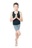 Meditation training. Little boy meditating isolated on white Royalty Free Stock Photo