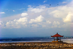 Meditation under sky of Asia. Photo photographed on beach Sanur. Bali island. Indonesia Royalty Free Stock Images