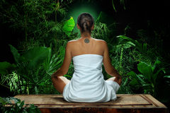 Meditation. View of nice young woman meditating in spa environment Stock Image