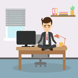 Meditation at work. Businessman sitting in lotus pose and meditating. Relaxation at workplace. Zen pose Stock Images