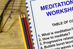 Meditation workshop. Concept- with a topics on a cover sheet Stock Image