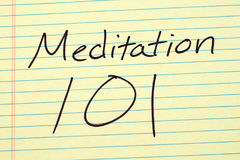 Meditation 101 On A Yellow Legal Pad. The words `Meditation 101` on a yellow legal pad Stock Photo