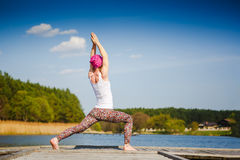 Meditation and yoga practicing near the lake Royalty Free Stock Photo