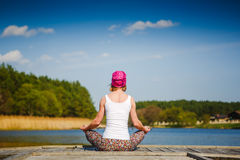 Meditation and yoga practicing near the lake Stock Photography