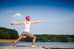 Meditation and yoga practicing near the lake Royalty Free Stock Photo