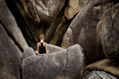 Meditation yoga session on rocks. Summer yoga session on rocks - tropical Koh Samui island, Thailand. Meditation - lotus pose - padma asana Royalty Free Stock Photo