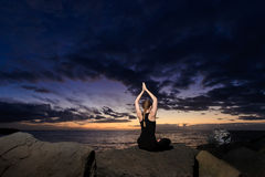 Meditation yoga on Tenerife beach Stock Images