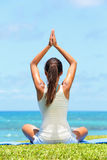 Meditation yoga woman meditating at beach. Relaxing in yoga pose. Serene relaxed female yoga instructor in calm nature sea scene Royalty Free Stock Photos
