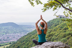 Meditation. Young woman meditating with a view Royalty Free Stock Images