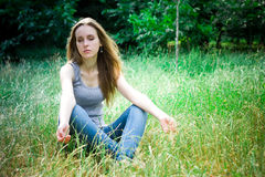 Meditation of young woman. Meditation of young pretty woman in a forest Stock Images