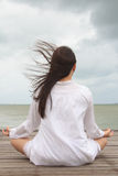 Meditation by young women Stock Image