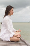 Meditation by young women Royalty Free Stock Image