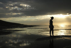 Meditations. Lone figure on the beach royalty free stock images