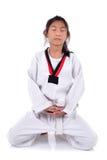 Meditative Asian girl in the Taekwondo school Stock Photography