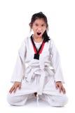 Meditative Asian girl in the Taekwondo school, isolated on white. Royalty Free Stock Photography