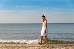 Meditative beautiful woman on a tropical beach Stock Photo