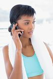 Meditative black haired woman phoning Stock Image