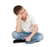 Meditative boy on white Royalty Free Stock Image