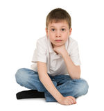 Meditative boy on white Stock Image