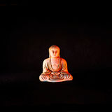 Meditative Buddha (front view). Sculpted with the tranquil majesty of those in ancient monasteries, this three-dimensional work of decorative Asian art creates a Stock Photography