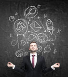 Meditative businessman in formal suit is thinking about building of some business relationships. Connected business icons are draw Stock Photos