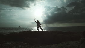 Meditative Exercise For The Body And Spirit. Training of a calm and tranquil mind, practicing breathing exercises with sea under cloudy sky on the background stock footage