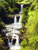 Meditative Falls. Three tiered waterfall in a lush, peaceful setting on the island of Hawaii royalty free stock images