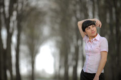 Meditative girl standing on a road Royalty Free Stock Photos