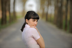 Meditative girl standing on a road Royalty Free Stock Photography
