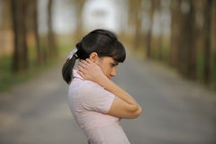 Meditative girl standing on a road Royalty Free Stock Image