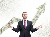 Meditative man. Dollar notes background with the growing arrow made from dollar notes. Stock Photos