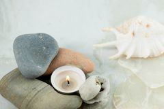 Meditative and relaxed state.A candle burns in a lamp made of stones. royalty free stock photography
