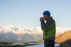 Meditative traveler drinking coffee and watching a sunrise Royalty Free Stock Photography