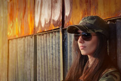 Meditative Young Woman Soldier in Camouflage Outfit Royalty Free Stock Image