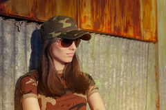 Meditative Young Woman Soldier in Camouflage Outfit Royalty Free Stock Photo