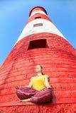 Meditazione al faro Fotografie Stock