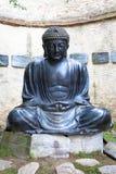 Meditera den japanska Buddhastatyn Arkivbild