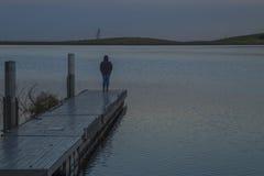 Meditera på Bethany Reservoir Royaltyfri Bild
