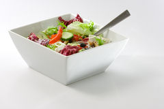 Mediteranean Salad. A bowl of Mediterranean salad isolated on white background Stock Images