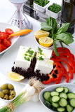 Mediteranian salad on a white table royalty free stock images