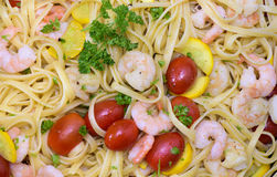 Mediterran italian pasta with prawns. And tomatoes Stock Photography