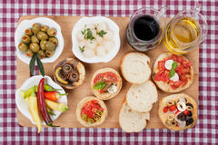 Mediterranean appetizer food. Served on wooden board Royalty Free Stock Photo