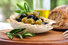 Mediterranean appetizers. Fresh olives, bread and olive oil Stock Image