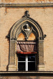 Mediterranean architecture. Old decorated window in Bologna Stock Photos