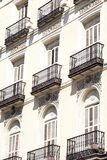 Mediterranean architecture in Spain. Old apartment building in Madrid. Stock Photo