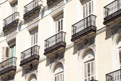 Mediterranean architecture in Spain. Old apartment building in Madrid. Stock Photos